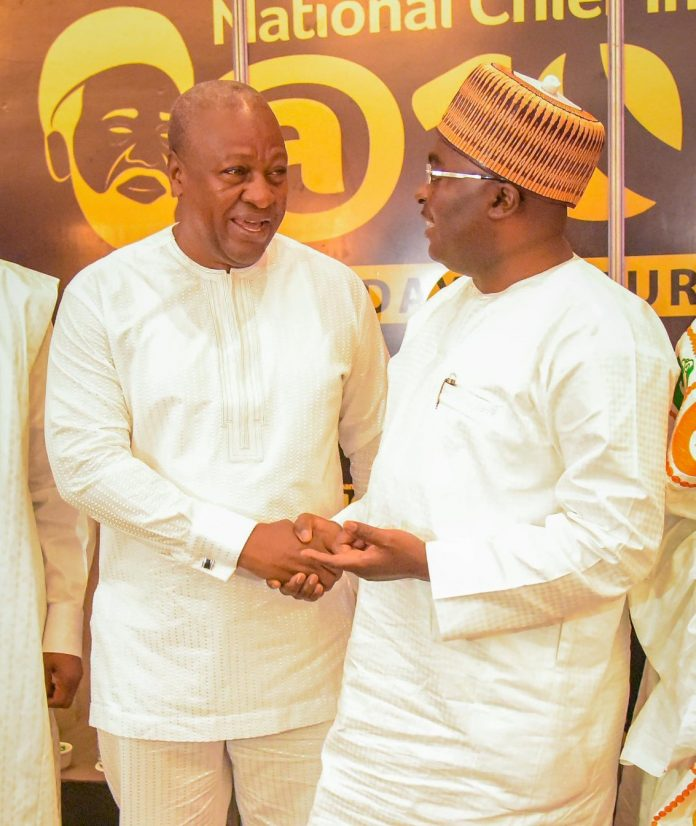 Bawumia and Mahama having a discussion at a public event