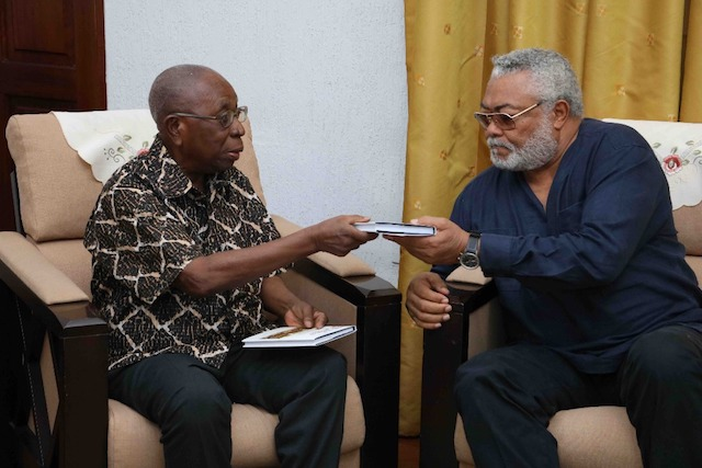 Samuel Ntim Darkwa presenting the book to Rawlings
