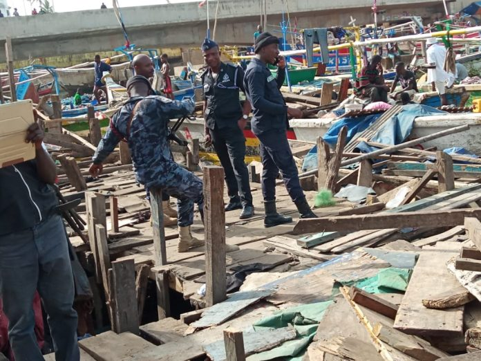 Policemen at the scene where the Criminal Dens were demolished at Elmina