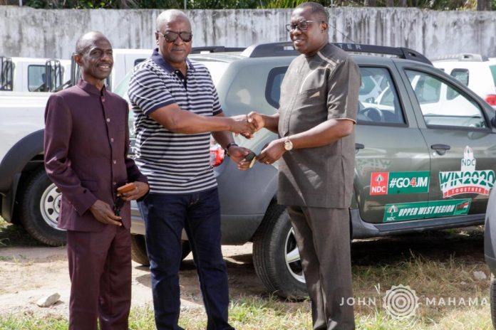Mr. John Mahama presenting the vehicles to party chairman Ofosu-Ampofo