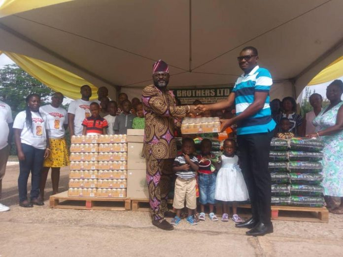 Mr. Tetteh presenting the items to the Tema SOS Village