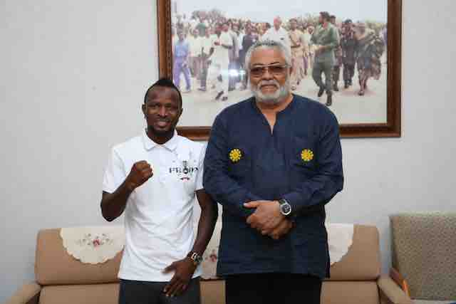 Rawlings and Agbeko in his office