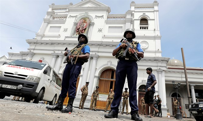 Local military officials at Sri Lanka church where explosion took place