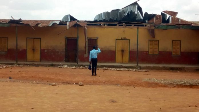 A NADMO official assessing the situation at the school after a Daily Mail Gh's report on the structure