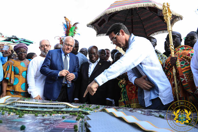 President being taken through the designs of Phase II of the Kumasi Central Market