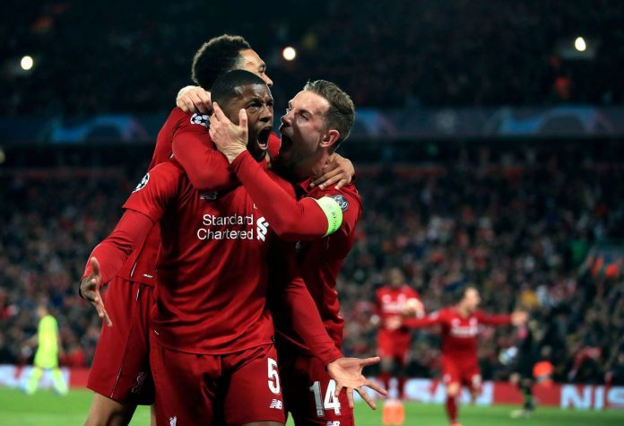 Liverpool's Georginio Wijnaldum, center, celebrates scoring his side's third goal of the game on Tuesday. (Peter Byrne/PA via AP)