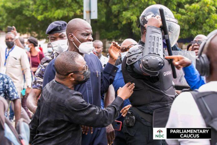 Minority leader, Haruna Iddrisu arguing with the police
