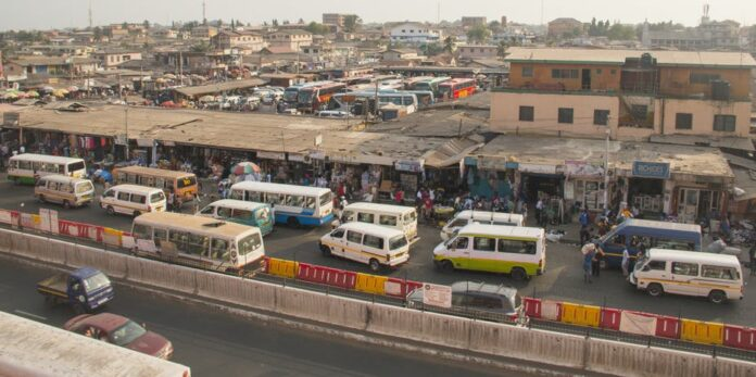 A bus and tro-tro station in Accra, Ghana. nicolasdecorte/Shutterstock/Editorial use only