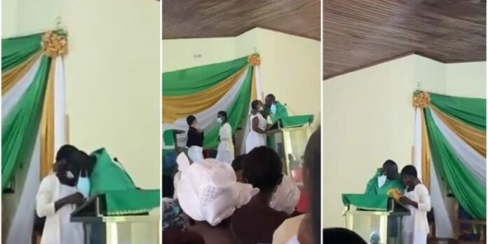 Father Obeng Larbi kissing at St Monica's