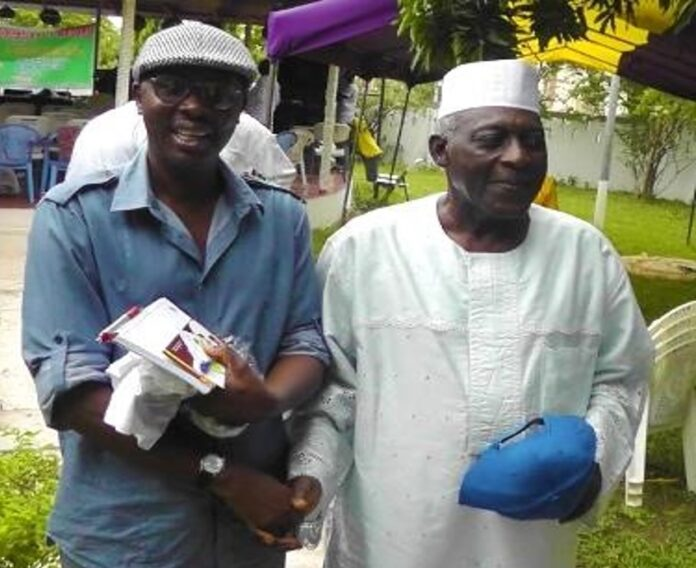 Professor Kofi Awoonor (right) with Amb. Alhaji Abdul-Rahman Harruna Attah (left) at a PAWA House