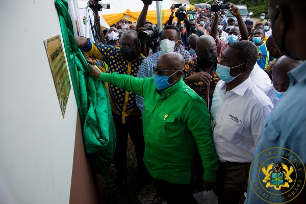 President Akufo-Addo unveiling the plaque to signify the commissioning the $2.1 million rubber processing factory
